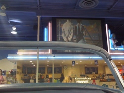 The snack area features a drive-in movie theater with real cars.